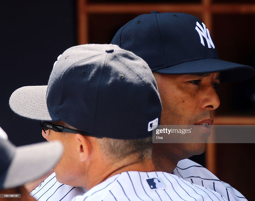 Mariano Rivera #42 of the New York Yankees is greeted by manager Joe Girardi #28 before the game against the Boston Red Sox during Opening Day on April 1, 2013 at Yankee Stadium in the Bronx borough of New York City.