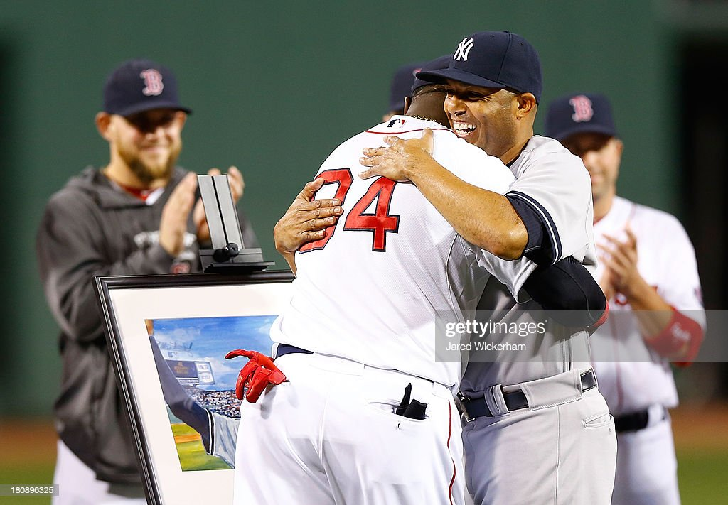 Mariano Rivera #42 of the New York Yankees is presented with a painting by David Ortiz #34 of the Boston Red Sox while being honored prior to the game against the Boston Red Sox on September 15, 2013 at Fenway Park in Boston, Massachusetts. Tonight will be Rivera's final appearance at Fenway Park as he is set to retire at the end of this season.