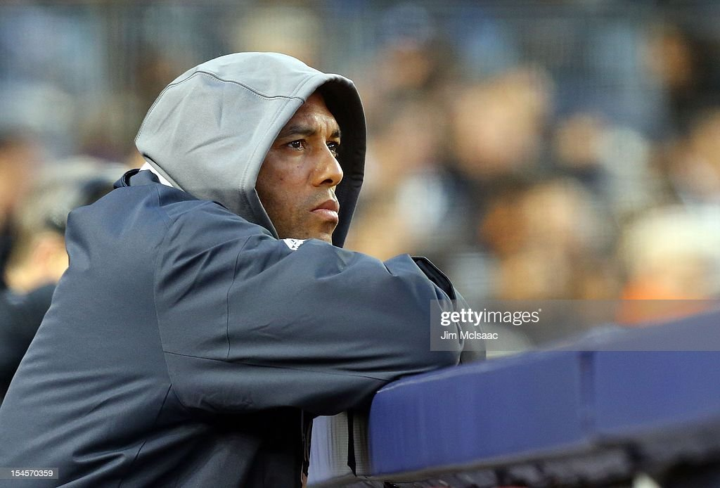 Mariano Rivera #42 of the New York Yankees looks on from the dugout during Game Five of the American League Division Series against the Baltimore Orioles at Yankee Stadium on October 12, 2012 in the Bronx borough of New York City. The Yankees defeated the Orioles 3-1 to win their best of five series three games to two.