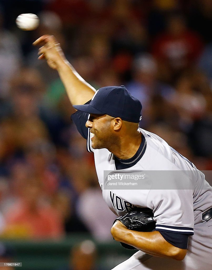 <a gi-track='captionPersonalityLinkClicked' href=/galleries/search?phrase=Mariano+Rivera&family=editorial&specificpeople=201607 ng-click='$event.stopPropagation()'>Mariano Rivera</a> #42 of the New York Yankees pitches against the Boston Red Sox during the game on August 19, 2013 at Fenway Park in Boston, Massachusetts.