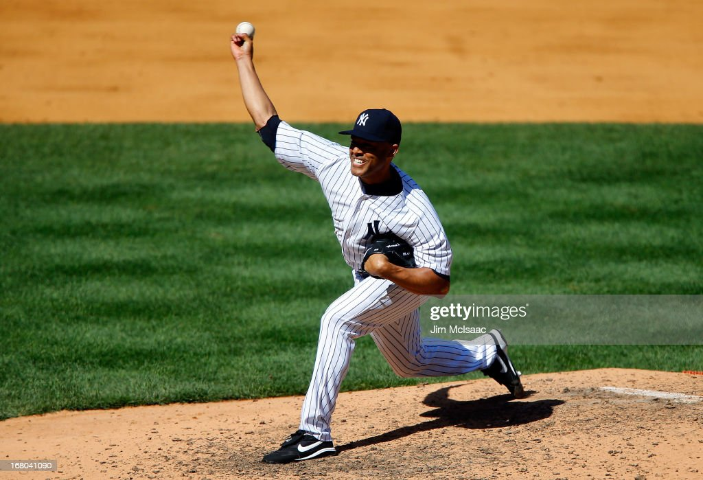 <a gi-track='captionPersonalityLinkClicked' href=/galleries/search?phrase=Mariano+Rivera&family=editorial&specificpeople=201607 ng-click='$event.stopPropagation()'>Mariano Rivera</a> #42 of the New York Yankees pitches in the ninth inning against the Oakland Athletics at Yankee Stadium on May 4, 2013 in the Bronx borough of New York City.