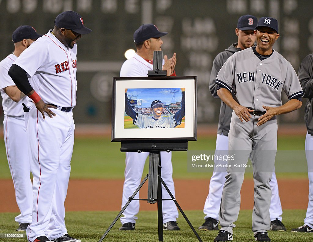 Mariano Rivera #42 of the New York Yankees reacts after receiving a portrait by David Ortiz #34 of the Boston Red Sox during a pre game ceremony on September 15, 2013 at Fenway Park in Boston Massachusetts.