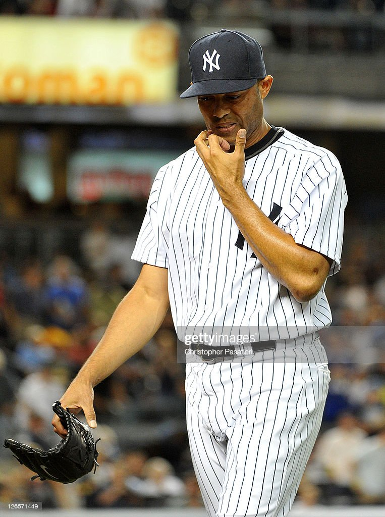 <a gi-track='captionPersonalityLinkClicked' href=/galleries/search?phrase=Mariano+Rivera&family=editorial&specificpeople=201607 ng-click='$event.stopPropagation()'>Mariano Rivera</a> #42 of the New York Yankees reacts as he walks back to the dugout after pitching the top of the ninth inning against the Boston Red Sox on September 25, 2011 at Yankee Stadium in the Bronx borough of New York City.