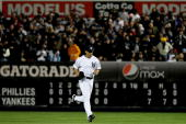 Mariano Rivera of the New York Yankees runs from the bullpen as he enters the game in the top of the eighth inning against the Philadelphia Phillies...