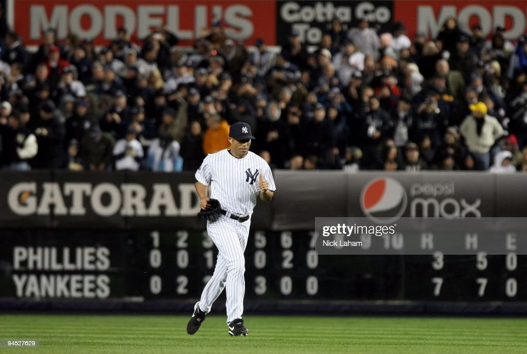 <a gi-track='captionPersonalityLinkClicked' href=/galleries/search?phrase=Mariano+Rivera&family=editorial&specificpeople=201607 ng-click='$event.stopPropagation()'>Mariano Rivera</a> #42 of the New York Yankees runs out from the bullpen to pitch against the Philadelphia Phillies in Game Six of the 2009 MLB World Series at Yankee Stadium on November 4, 2009 in the Bronx borough of New York City. The Yankees won 7-3.