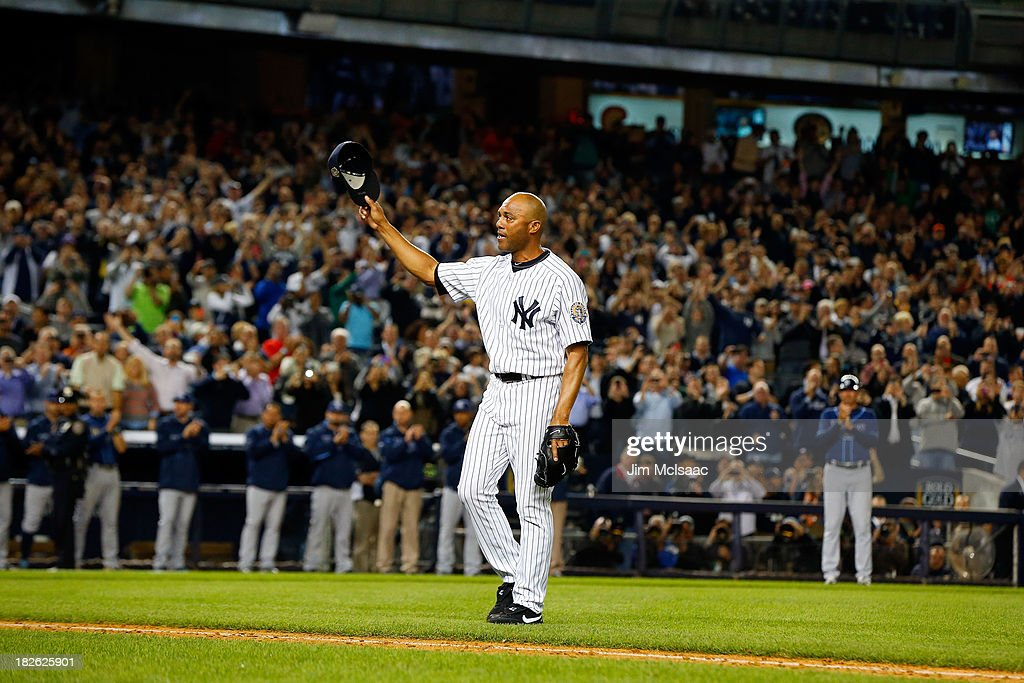 Mariano Rivera #42 of the New York Yankees salutes the crowd as walks to the dugout after leaving a game against the Tampa Bay Rays in the ninth inning at Yankee Stadium on September 26, 2013 in the Bronx borough of New York City. The Rays defeated the Yankees 4-0.