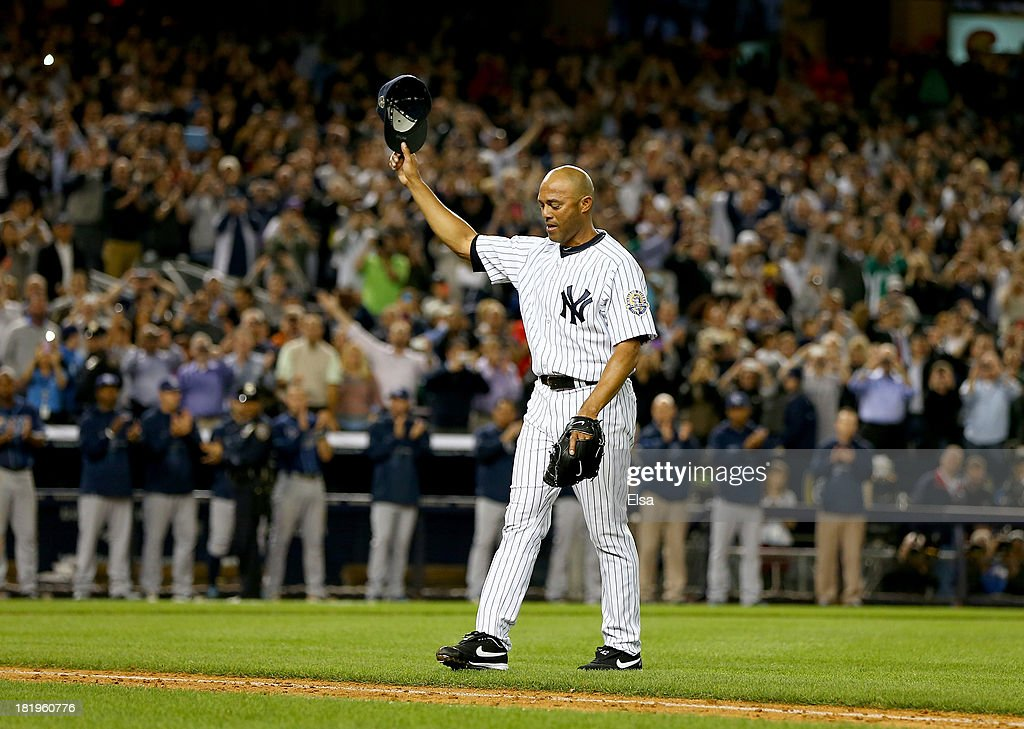 Mariano Rivera #42 of the New York Yankees salutes the fans after he is pulled from the game in the ninth inning against the Tampa Bay Rays on September 26, 2013 at Yankee Stadium in the Bronx borough of New York City.