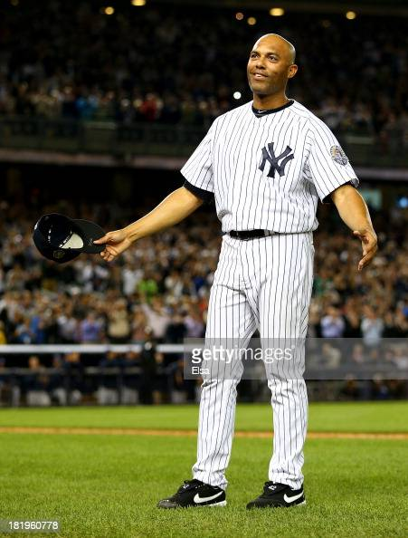 Mariano Rivera of the New York Yankees salutes the fans after he is pulled from the game in the ninth inning against the Tampa Bay Rays on September...