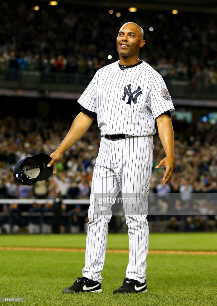 <a gi-track='captionPersonalityLinkClicked' href=/galleries/search?phrase=Mariano+Rivera&family=editorial&specificpeople=201607 ng-click='$event.stopPropagation()'>Mariano Rivera</a> #42 of the New York Yankees salutes the fans after he is pulled from the game in the ninth inning against the Tampa Bay Rays on September 26, 2013 at Yankee Stadium in the Bronx borough of New York City.