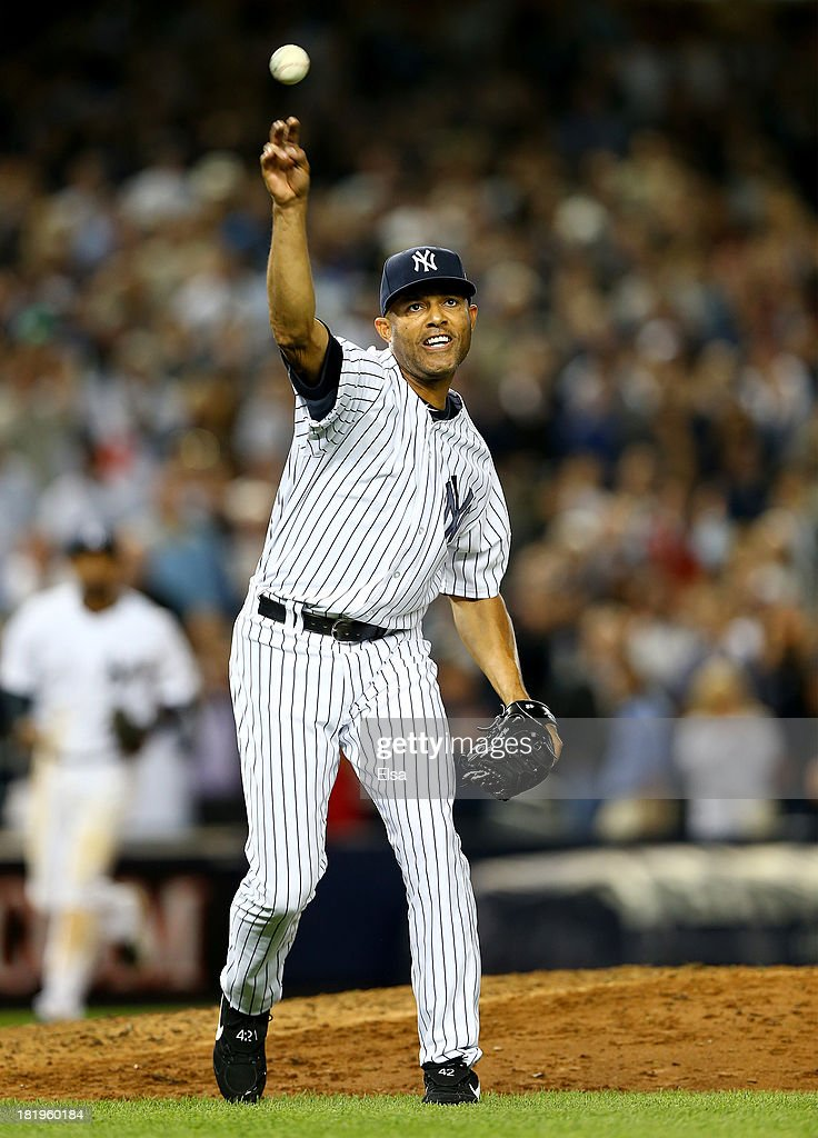 <a gi-track='captionPersonalityLinkClicked' href=/galleries/search?phrase=Mariano+Rivera&family=editorial&specificpeople=201607 ng-click='$event.stopPropagation()'>Mariano Rivera</a> #42 of the New York Yankees sends the ball to first for the out in the eighth inning against the Tampa Bay Rays on September 26, 2013 at Yankee Stadium in the Bronx borough of New York City.