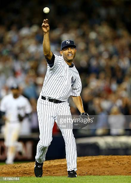 Mariano Rivera of the New York Yankees sends the ball to first for the out in the eighth inning against the Tampa Bay Rays on September 26 2013 at...