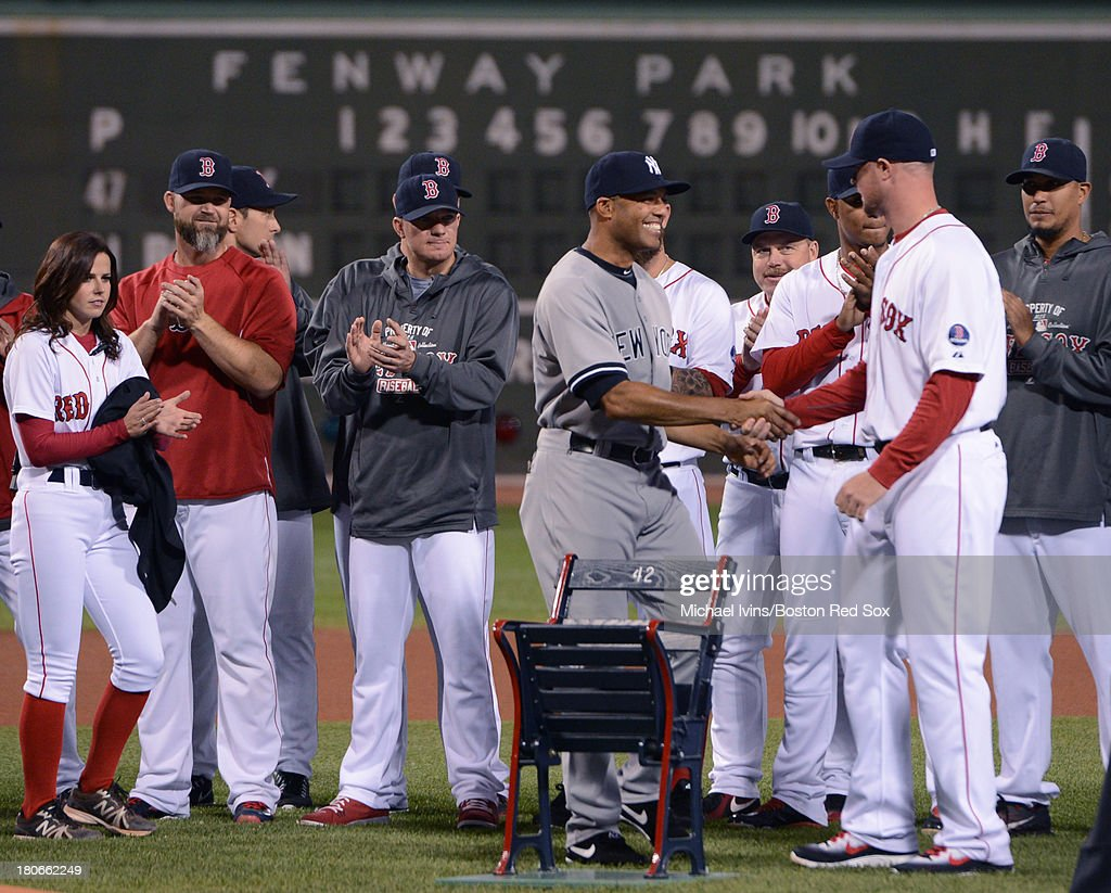 Mariano Rivera #42 of the New York Yankees shakes hands with Jon Lester #31 of the Boston Red Sox after receiving a Fenway Park seat as a gift during a pre game ceremony in his honor on September 15, 2013 at Fenway Park in Boston Massachusetts.