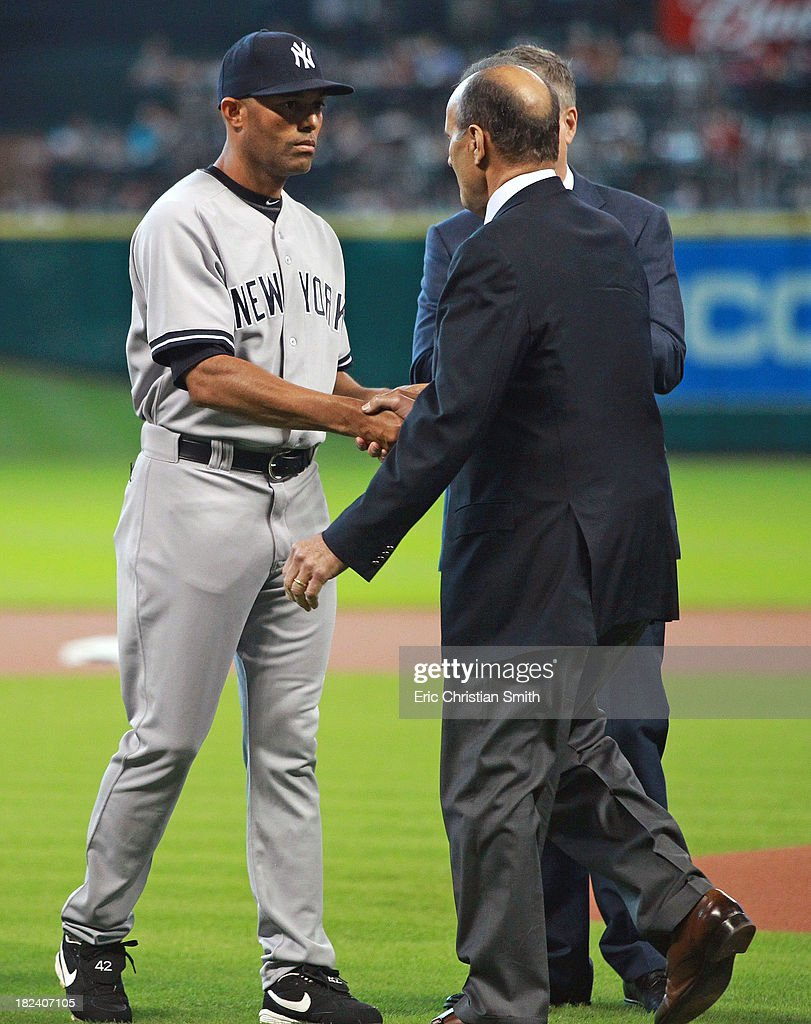 Mariano Rivera #42 (L) of the New York Yankees shakes the hand of former Yankees manager Joe Torre before a game against the Houston Astros on September 29, 2013 at Minute Maid Park in Houston, TX.