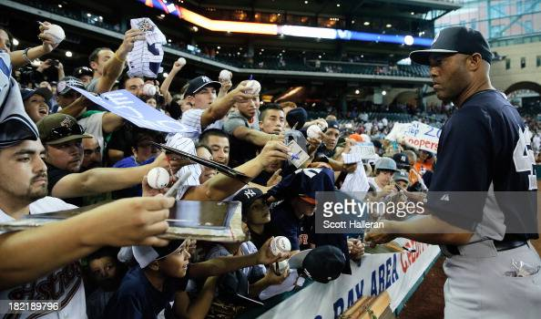 Mariano Rivera of the New York Yankees signs autographs for fans before the game against the Houston Astros at Minute Maid Park on September 28 2013...