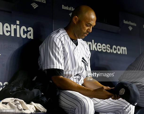 Mariano Rivera of the New York Yankees sits in the dugout in the bottom of the eighth inning against the Tampa Bay Rays on September 26 2013 at...