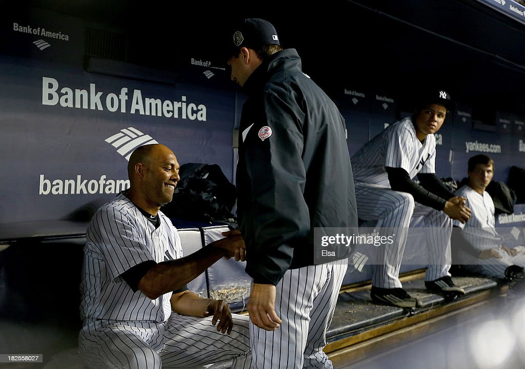 <a gi-track='captionPersonalityLinkClicked' href=/galleries/search?phrase=Mariano+Rivera&family=editorial&specificpeople=201607 ng-click='$event.stopPropagation()'>Mariano Rivera</a> #42 of the New York Yankees sits in the dugout in the ninth inning against the Tampa Bay Rays on September 26, 2013 at Yankee Stadium in the Bronx borough of New York City.