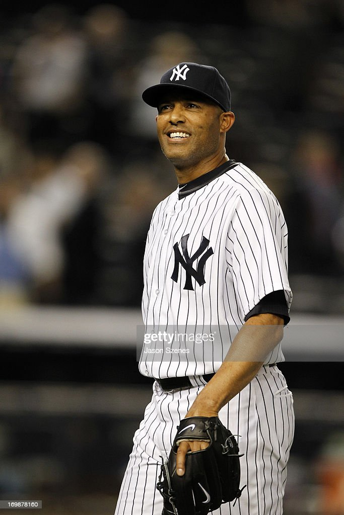 <a gi-track='captionPersonalityLinkClicked' href=/galleries/search?phrase=Mariano+Rivera&family=editorial&specificpeople=201607 ng-click='$event.stopPropagation()'>Mariano Rivera</a> #42 of the New York Yankees smiles as he walks off the field at the conclusion of his teams game against the Cleveland Indians at Yankees Stadium on June 3, 2013 in the Bronx borough of New York City. (Photo by Jason Szenes/Getty Images
