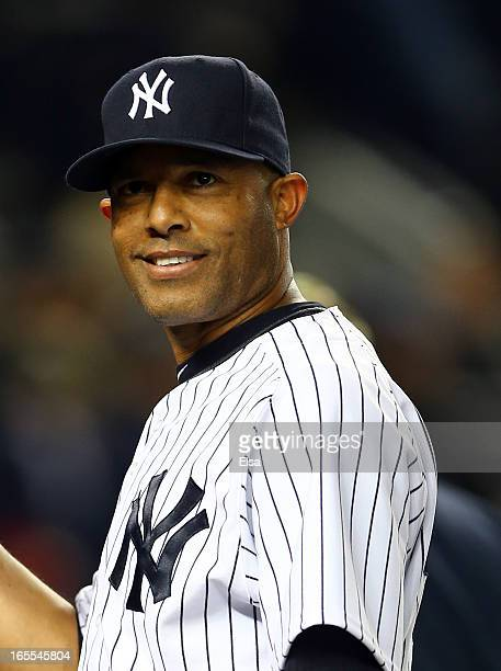 Mariano Rivera of the New York Yankees smiles as he walks off the field after the game against the Boston Red Sox on April 4 2013 at Yankee Stadium...