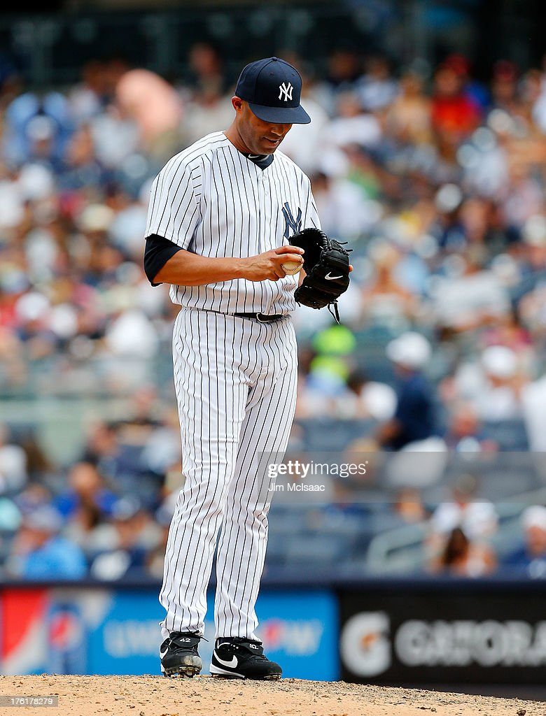 <a gi-track='captionPersonalityLinkClicked' href=/galleries/search?phrase=Mariano+Rivera&family=editorial&specificpeople=201607 ng-click='$event.stopPropagation()'>Mariano Rivera</a> #42 of the New York Yankees stands on the mound after surrendering a game tying home run in the ninth inning against the Detroit Tigers at Yankee Stadium on August 11, 2013 in the Bronx borough of New York City.