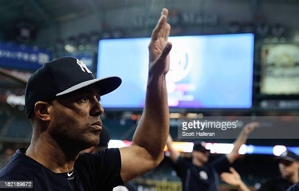 Mariano Rivera of the New York Yankees stretches on the field before the game against the Houston Astros at Minute Maid Park on September 28 2013 in...