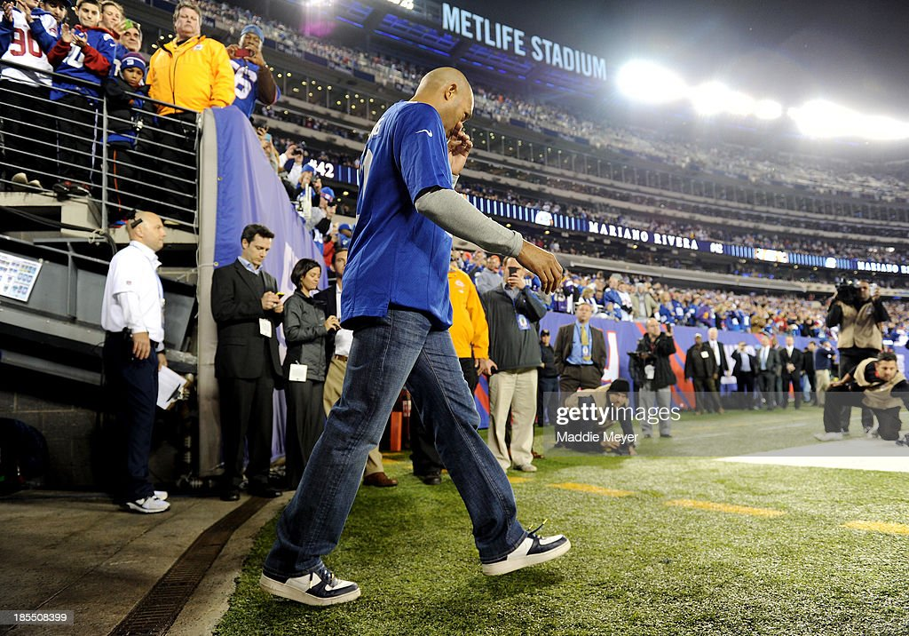 Mariano Rivera of the New York Yankees takes the field as an honorary captain for the New York Giants against the Minnesota Vikings during a game at MetLife Stadium on October 21, 2013 in East Rutherford, New Jersey.