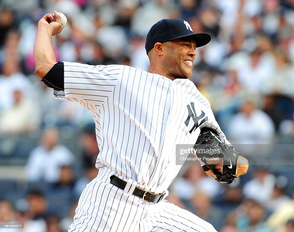<a gi-track='captionPersonalityLinkClicked' href=/galleries/search?phrase=Mariano+Rivera&family=editorial&specificpeople=201607 ng-click='$event.stopPropagation()'>Mariano Rivera</a> #42 of the New York Yankees throws a pitch during the game against the San Francisco Giants on September 22, 2013 at Yankee Stadium in the Bronx borough of New York City.