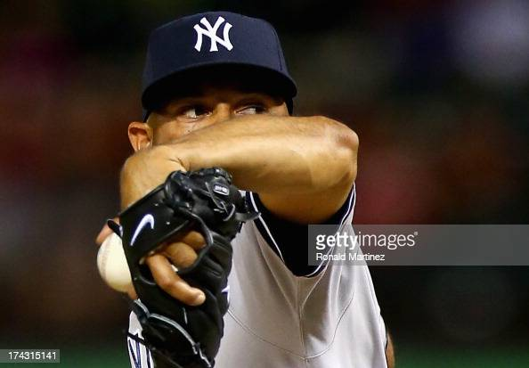 Mariano Rivera of the New York Yankees throws against the Texas Rangers at Rangers Ballpark in Arlington on July 23 2013 in Arlington Texas