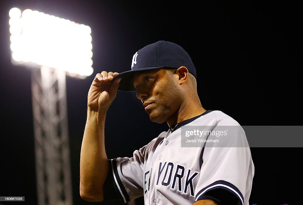 <a gi-track='captionPersonalityLinkClicked' href=/galleries/search?phrase=Mariano+Rivera&family=editorial&specificpeople=201607 ng-click='$event.stopPropagation()'>Mariano Rivera</a> #42 of the New York Yankees tips his hat to the crowd after being honored prior to the game against the Boston Red Sox on September 15, 2013 at Fenway Park in Boston, Massachusetts. Tonight will be Rivera's final appearance at Fenway Park as he is set to retire at the end of this season.