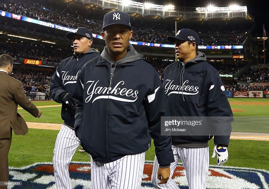 Mariano Rivera #42 of the New York Yankees walks off the field after Game Five of the American League Division Series against the Baltimore Orioles with teammates Freddy Gracia #36 (L) and Hiroki Kuroda #18 at Yankee Stadium on October 12, 2012 in the Bronx borough of New York City. The Yankees defeated the Orioles 3-1 to win their best of five series three games to two.