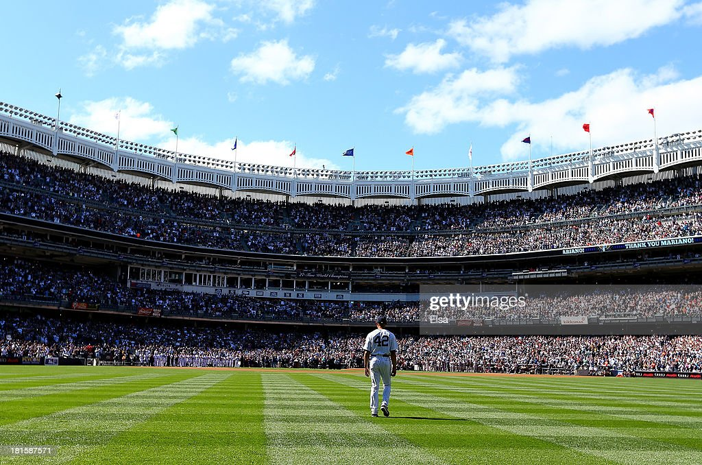 <a gi-track='captionPersonalityLinkClicked' href=/galleries/search?phrase=Mariano+Rivera&family=editorial&specificpeople=201607 ng-click='$event.stopPropagation()'>Mariano Rivera</a> #42 of the New York Yankees walks out of the bullpen before the game against the San Francisco Giants during interleague play on September 22, 2013 at Yankee Stadium in the Bronx borough of New York City. Rivera was honored by the New York Yankees today with <a gi-track='captionPersonalityLinkClicked' href=/galleries/search?phrase=Mariano+Rivera&family=editorial&specificpeople=201607 ng-click='$event.stopPropagation()'>Mariano Rivera</a> Day.