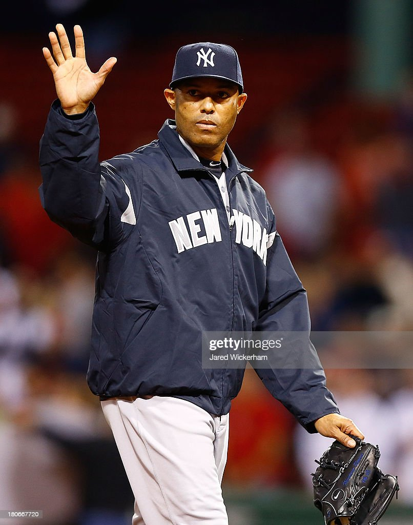 <a gi-track='captionPersonalityLinkClicked' href=/galleries/search?phrase=Mariano+Rivera&family=editorial&specificpeople=201607 ng-click='$event.stopPropagation()'>Mariano Rivera</a> #42 of the New York Yankees waves to the crowd after walking off of the Fenway Park field for the final time following their 9-2 loss against the Boston Red Sox on September 15, 2013 at Fenway Park in Boston, Massachusetts. Rivera is set to retire at the end of this season.
