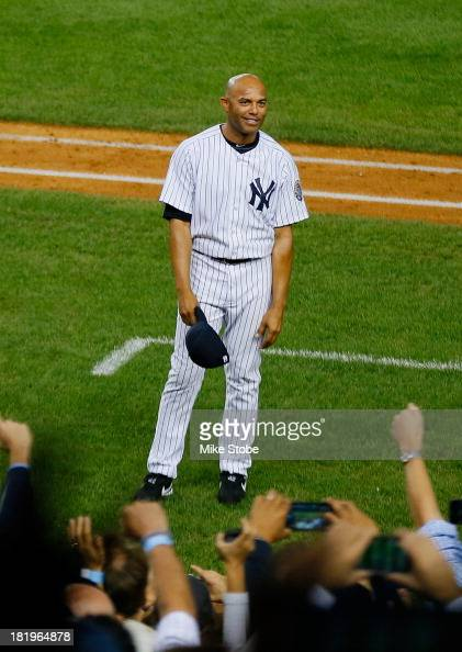 Mariano Rivera of the New York Yankees waves to the crowd after leaving the game against the Tampa Bay Rays in the ninth inning at Yankee Stadium on...