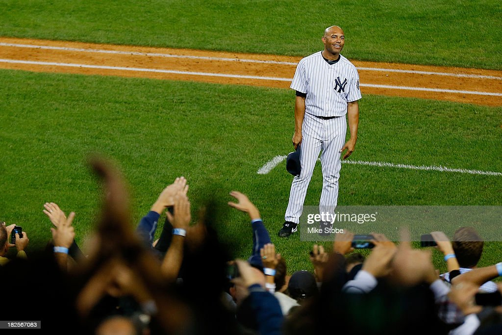 Mariano Rivera #42 of the New York Yankees waves to the crowd after leaving the game against the Tampa Bay Rays in the ninth inning at Yankee Stadium on September 26, 2013 in the Bronx borough of New York City. Rays defeated the Yankees 4-0.