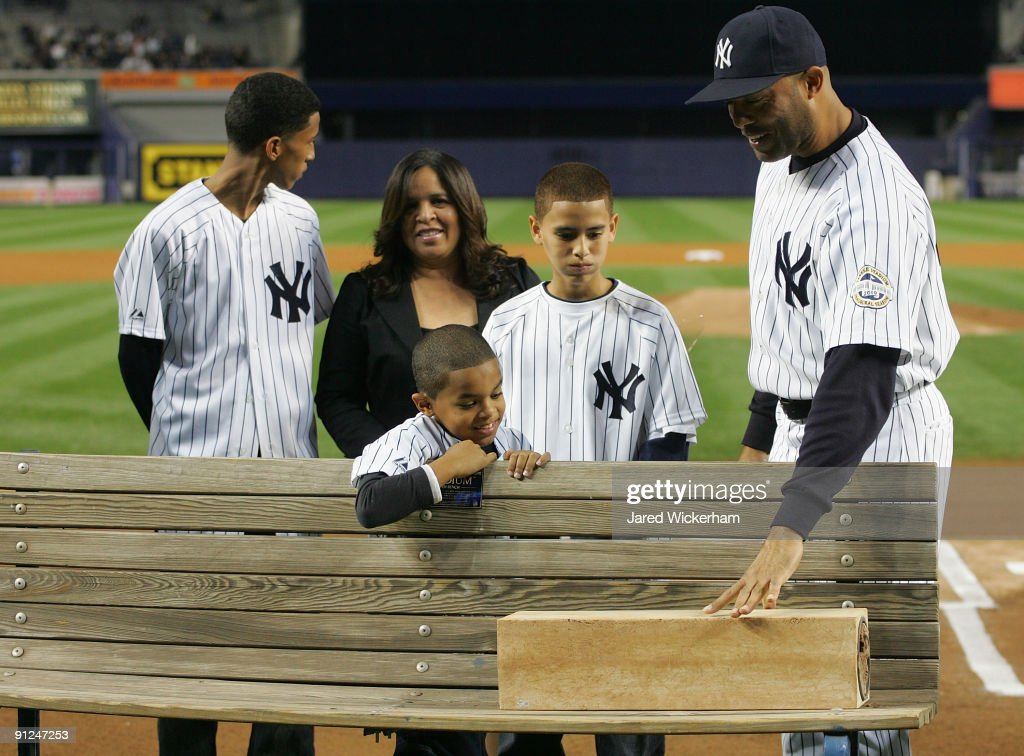 <a gi-track='captionPersonalityLinkClicked' href=/galleries/search?phrase=Mariano+Rivera&family=editorial&specificpeople=201607 ng-click='$event.stopPropagation()'>Mariano Rivera</a> reacts after his old bullpen bench from Yankee Stadium and the pitching rubber from his 500th save was presented to him before the game on September 29, 2009 at Yankee Stadium in the Bronx borough of New York City.