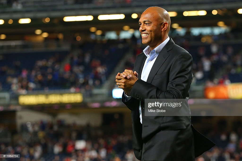 Mariano Rivera wals to greet David Ortiz #34 of the Boston Red Sox as he is honored before a game against the New York Yankees at Yankee Stadium on September 29, 2016 in the Bronx borough of New York City. Yankees defeated the Red Sox 5-1