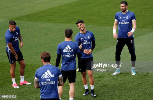 Marianoof Real Madrid Nacho Fernández of Real Madrid Marco Asensio of Real Madrid and Kiko Casilla of Real Madrid warms up during a training session...