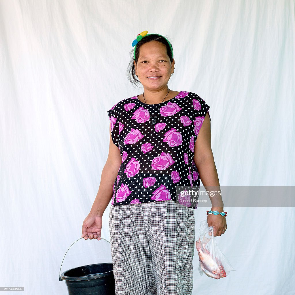 Maribel Beloria fish saleswoman Pooc Bantayan Island The Philippines Every morning at 7 am fisherwomen meet fishermen as they return from the sea...