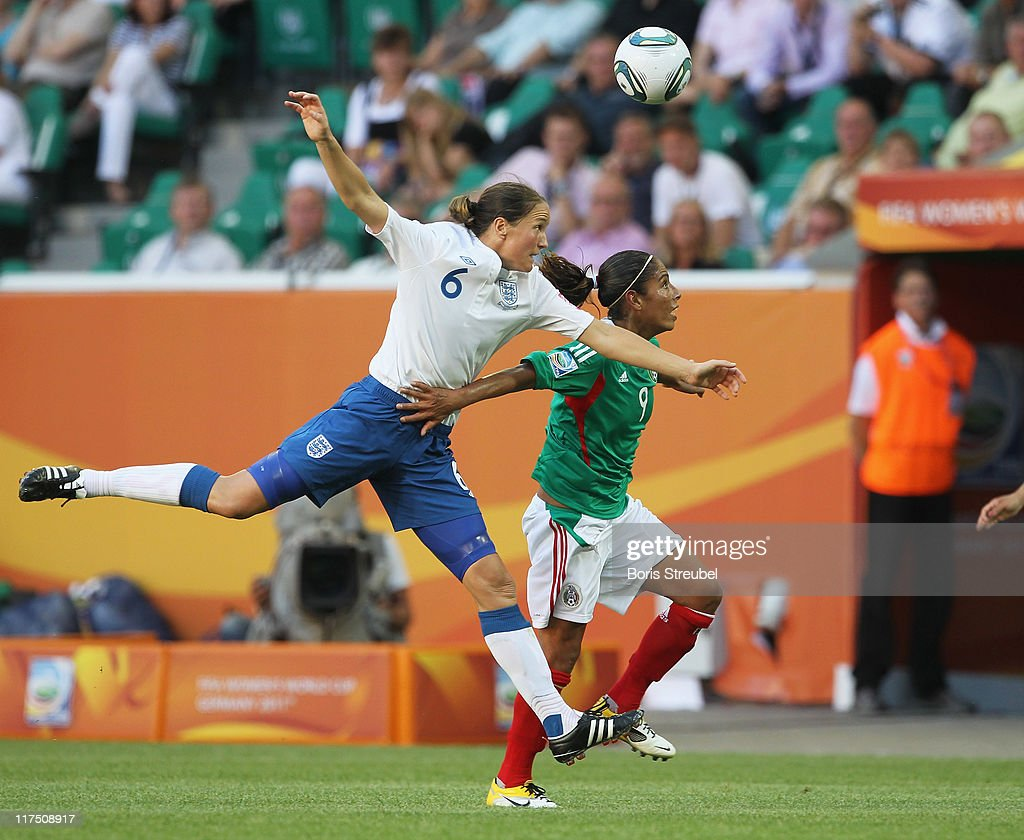 Maribel Dominguez of Mexico (R) and Casey Stoney (L) of England (R) jump for a header during the FIFA Women's World Cup Group B match between Mexico and England at Arena im Allerpark on June 27, 2011 in Wolfsburg, Germany.