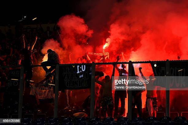 Maribor supporters light flares as they celebrate their team's first goal during the UEFA Champions League group G match between FC Schalke 04 and NK...