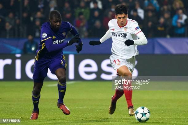 Maribor's French defender JeanClaude Billong vies with Sevilla's Argentinian midfielder Joaquin Correa during the UEFA Champions League Group E...