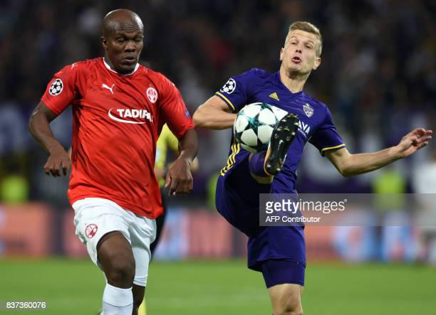 Maribor's Martin Milec challenges Hapoel Beer Sheva's Anthony Nwakaeme during the UEFA Champions League playoff football match between NK Maribor and...