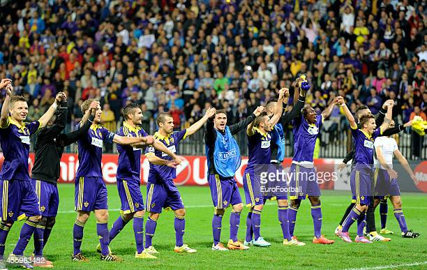 Maribor's players celebrate after the UEFA Group G Champions League football match between NK Maribor and Sporting Lisbon at the Ljudski vrt Stadium...