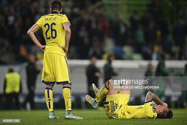 Maribor's players react at the end of the UEFA Champions League football match Sporting CP vs NK Maribor at the Jose Alvalade stadium in Lisbon on...