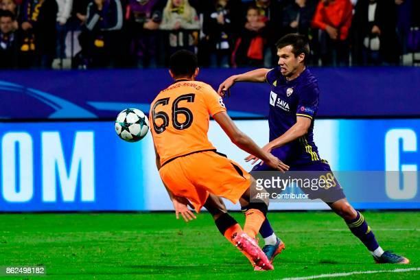 Maribor's Slovenian midfielder Damjan Bohar vies with Liverpool's British defender Trent AlexanderArnold during the UEFA Champions League group E...