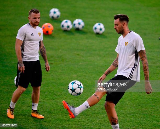 NK Maribor's Slovenian midfielder Dino Hotic controls the ball next to NK Maribor's Slovenian midfielder Amir Dermisevic during a training session at...