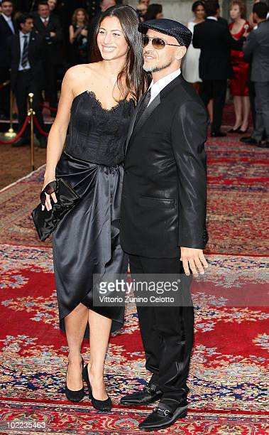 Marica Pellegrini and Eros Ramazzotti attend the Dolce Gabbana '20 Years of Menswear' during Milan Fashion Week Spring/Summer 2011 on June 19 2010 in...