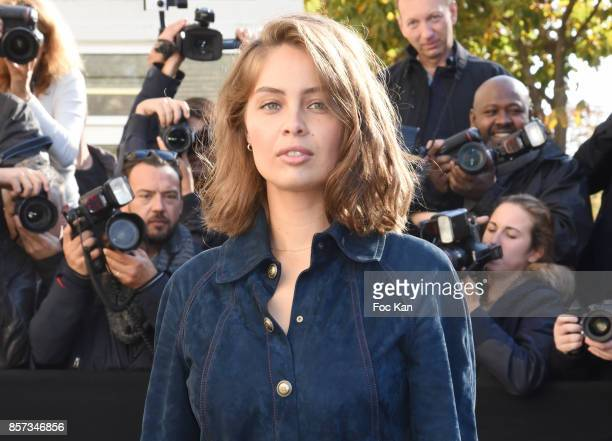 Marie Ange Casta poses during the Chanel show as part of the Paris Fashion Week Womenswear Spring/Summer 2018 on October 3 2017 in Paris France