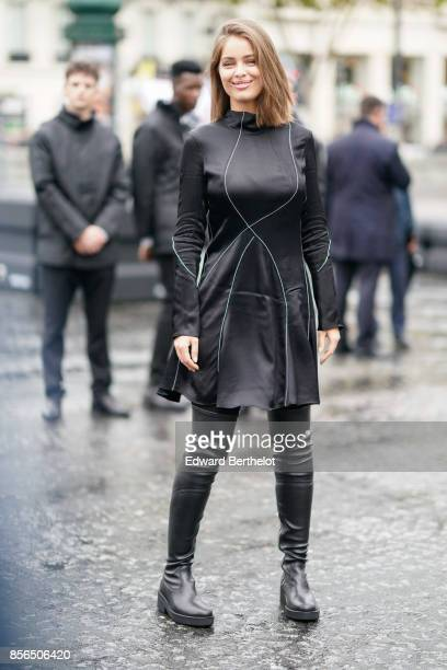 Marie Ange Casta wears a black dress black thigh high boots and attends Le Defile L'Oreal Paris as part of Paris Fashion Week Womenswear...