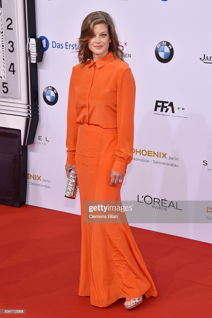 Marie Baeumer wearing a dress by Lala Berlin and bag by Jimmy Choo attends the Lola German Film Award on May 27 2016 in Berlin Germany