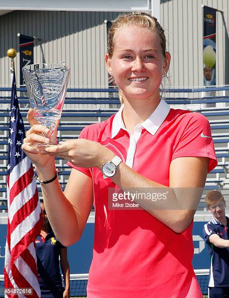 Marie Bouzkova of the Czech Republic celebrates with the trophy after defeating Anhelina Kalinina of the Ukraine during their junior girls' singles...